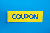Yellow Sticky Paper With Coupon Message On Blue Background