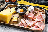 Ingredients for Pasta Carbonara. Traditional Italian food. Gray background. Top view