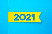 Yellow Label Sticker On A Blue Background. 2021 Concept.