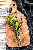 Organic thyme. A bunch of fresh herbs. White background. Top view