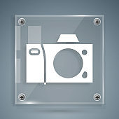 White Photo camera icon isolated on grey background. Foto camera icon. Square glass panels. Vector Illustration