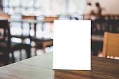 Mock up acrylic frame posters pattern template forms background, blank menu frame on table in coffee shop or restaurant stand for your text of display your product