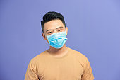 Man wearing hygienic mask to prevent infection, airborne respiratory illness such as flu, 2019-nCoV.