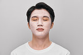 men skin care mask on white background