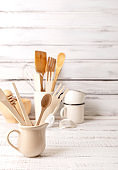 Baking kitchenware and baking products on white wooden background.
