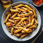 Pasta penne with mushrooms and sauce