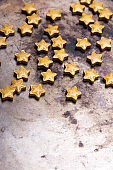 Small golden stars on a old metal background, copy space