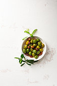 Variety pickled olives in bowl top view