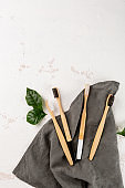 Natural eco bamboo toothbrushes top view, zero waste and sustainable lifestyle
