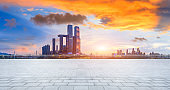 Empty floor and city skyline with buildings in Chongqing at sunset,China.