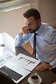 Businessman working with graph data at office