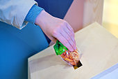 Woman hand makes donation food - dried fruits, lifestyle. Concept of helping people during the coronavirus epidemic