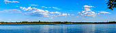 Beautiful lake and blue sky with white clouds natural scenery.