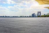 Race track ground and Suzhou city skyline on a sunny day.