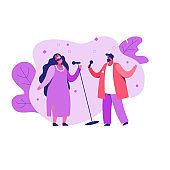 Singers man and woman with a microphone
