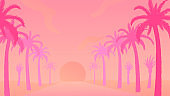 Tropical sunset with palm trees standing in raw.