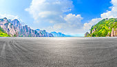 Race track road and green mountain with beautiful clouds,panoramic view.