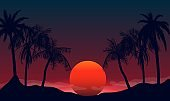 Sunset silhouettes of palm trees at night. Tropical beach on background red black setting sun.