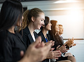 Businesswomen celebrating success and Business executives applauding in a business meeting