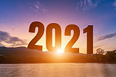 Happy New Year Numbers 2021, landscape lake views at Silhouette the hill early in nature forest Mountain views with evening blue dramatic sunset sky  background, Happy new year concept.