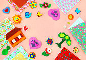 Colorful crafts made of felt and space for text.