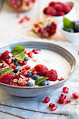 Yogurt with fresh fruit and cereals in a bowl, healthy breakfast
