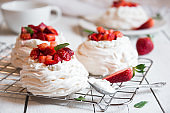 Delicious Pavlova cake with meringue and fresh strawberries