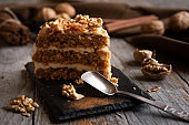 Piece of cake. Carrots and walnuts cake with creamy cheese