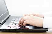 Close-up of hands on laptop keyboard. Online work concept