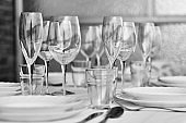Table settings with diverse glassware and tableware closeup