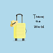 Yellow suitcase with travel hat. Vector illustration.