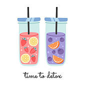 Fresh, fruit water in glasses jar with straw