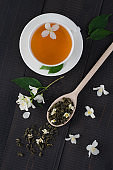 Cup fragrant of  tea with jasmine flowers