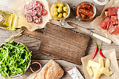 Italian food on wooden background