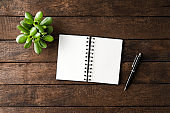 Elegant empty notebook on wooden table. Business background