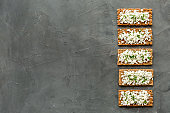 Cottage cheese toast pattern on grey desk top view copy space