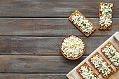 Sandwiches with cottage cheese and greenery for breakfast top view copy space