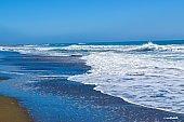 Gorgeous blue Pacific Ocean waves hit beach