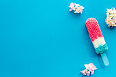 Colorful fruit popsicle - ice cream on sticks, top view