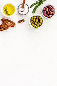 Italian olives, oil, bread - appetizer and snacks - top view copy space