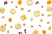 Pattern of snacks mix top view - nuts and dried fruits
