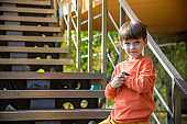 Photo of the boy looking at a smart watch. Children and modern technology. Kid calling to his friends or parents after school