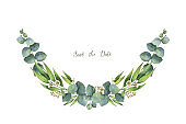 Watercolor green floral wreath with eucalyptus leaves and branches isolated on white background.
