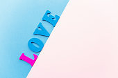 I love you on designer cardboard fashionable shades of blue and pink. wooden letters of blue and bright pink color. sign card design for relationships, romance, love and Valentines day.