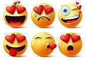 Smiley emoticon and emoji with heart vector faces set.