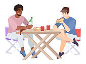 Two men eat and chat at table flat vector illustration. Guys with hot dogs and soft drinks, folding furniture. Couple of friends at city picnic isolated cartoon characters on white background