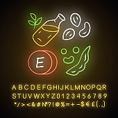 Vitamin E neon light icon. Peanuts, peas and beans. Seed oil. Healthy diet. Minerals, antioxidants. Tocopherol food source. Glowing sign with alphabet, numbers, symbols. Vector isolated illustration