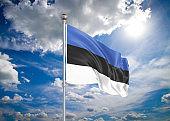 Realistic flag. 3D illustration. Colored waving flag of Estonia on sunny blue sky background.