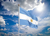 Realistic flag. 3D illustration. Colored waving flag of Argentina on sunny blue sky background.
