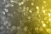 Blurred glitter background yellow gray color.